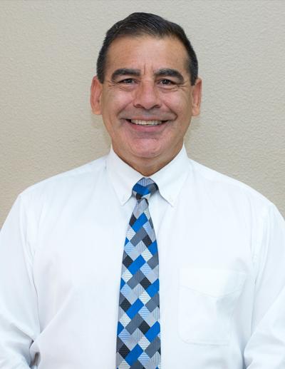 Dr. Mark Luzania